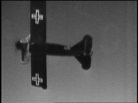 B/W 1910s AIRTOAIR World War I German biplane turning diving toward clouds ground