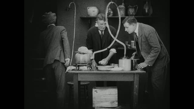 1910s alcohol is made in a home laboratory - food and drink bildbanksvideor och videomaterial från bakom kulisserna