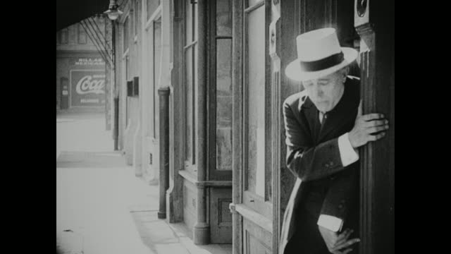 1910s an inebriated man stumbles down the sidewalk - 1910 stock videos & royalty-free footage