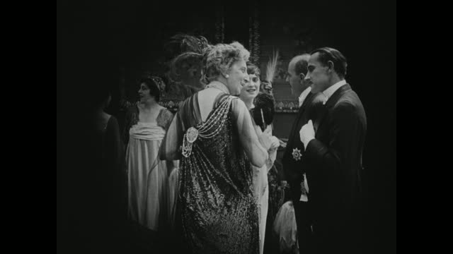 1910s attendees of a grand ball introduce themselves - 1910 stock-videos und b-roll-filmmaterial