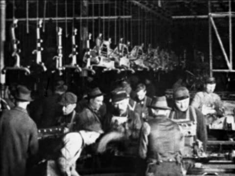 b/w 1910s auto workers working on car parts on assembly line / ford factory, highland park, mi - ford motor company stock videos and b-roll footage
