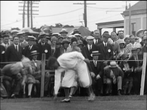 b/w 1910s bobby jones picking up tee at golf tournament / crowd in background - 1910 stock videos & royalty-free footage