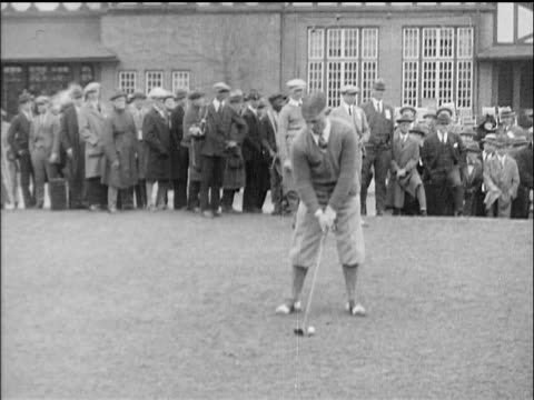 b/w 1910s bobby jones teeing off at golf tournament / crowd in background - golf shoe stock videos & royalty-free footage