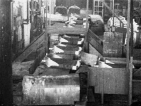 b/w 1910s car grilles on conveyor belt / ford factory, highland park, mi / industrial - ford motor company stock videos and b-roll footage