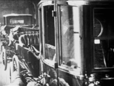 b/w 1910s cars on assembly line / worker's head barely visible / ford factory, highland park, mi - ford motor company stock videos and b-roll footage