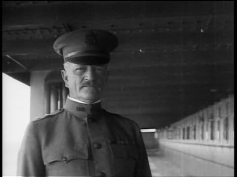 b/w 1910s close up portrait general john pershing standing on ship's deck / removes hat smooths hair - john pershing stock videos & royalty-free footage