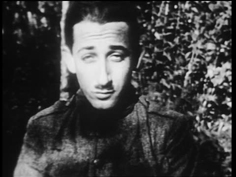 vídeos de stock, filmes e b-roll de b/w 1910s close up shellshocked world war i veteran stuttering outdoors / newsreel - só um adulto de idade mediana