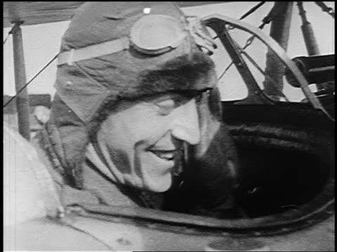 b/w 1910s close up world war i flying ace eddie rickenbacker sitting in cockpit smiling waving - eddie rickenbacker bildbanksvideor och videomaterial från bakom kulisserna