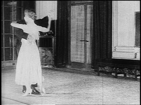 b/w 1910s couple in formalwear ballroom dancing in room - yorkville illinois stock videos & royalty-free footage