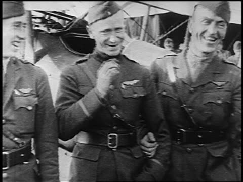 b/w 1910s pan eddie rickenbacker in uniform standing with two other pilots smiling / one smoking - エディ リッケンバッカー点の映像素材/bロール