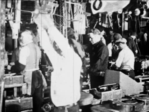 b/w 1910s factory workers work on car parts on assembly line / ford factory, highland park, mi - ford motor company stock videos and b-roll footage
