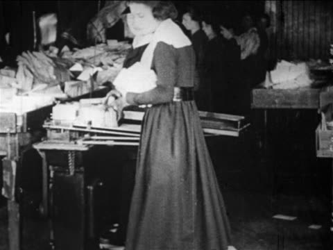 b/w 1910s female postal worker drops pile of mail / documentary - postal worker stock videos & royalty-free footage