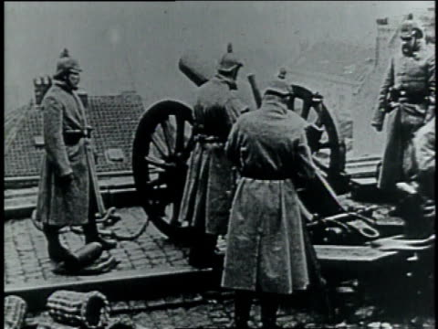 1910s ws german soldiers lighting a cannon / germany - 1910 stock-videos und b-roll-filmmaterial