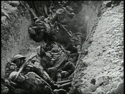 1910s ms german soldiers stepping across men in a trench / europe - trench stock videos & royalty-free footage