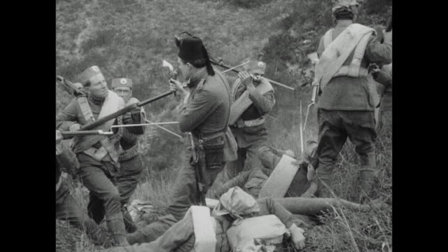 stockvideo's en b-roll-footage met 1910s gunfire and death mar the hillside as troops come head to head during the balkan war - 1915