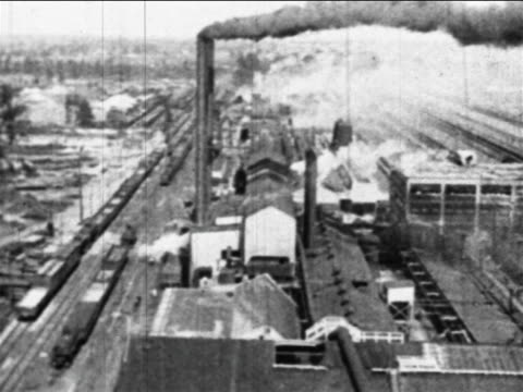 B/W 1910s high angle wide shot PAN Ford factory with smokestacks / Highland Park, MI / industrial