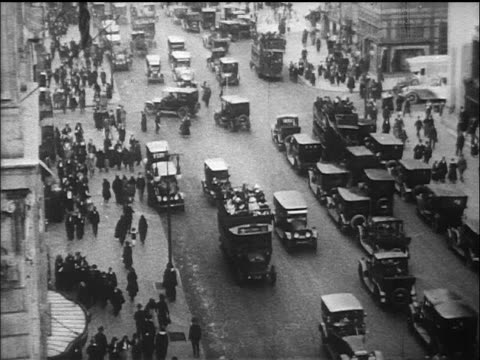 stockvideo's en b-roll-footage met b/w 1910s high angle wide shot tilt down traffic + pedestrians on fifth avenue / nyc / documentary - 1915