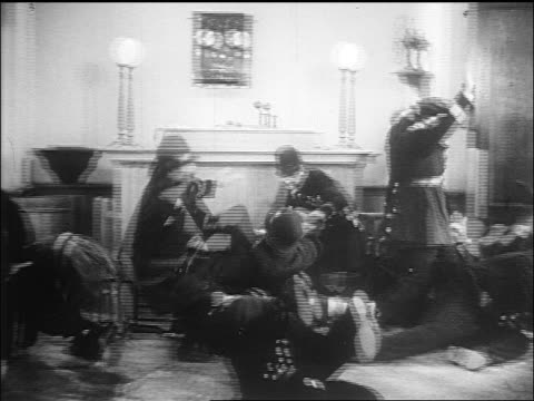 b/w 1910s keystone cops tumbling into pile + running frantically in stationhouse / film - crime stock videos & royalty-free footage