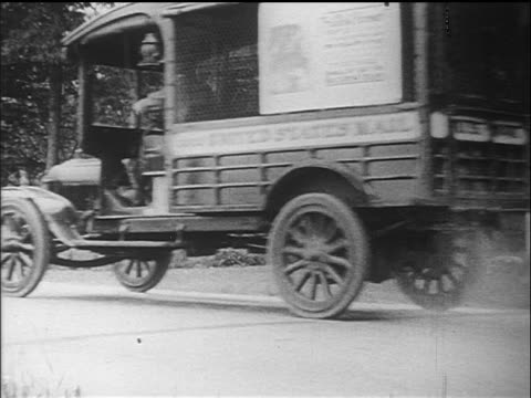 b/w 1910s mail truck stopping in front of house where man waits with packages / documentary - ford motor company stock videos & royalty-free footage