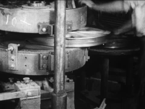 b/w 1910s male factory worker attaches steel rim to wooden weel with press machine / ford factory - ford motor company stock videos and b-roll footage