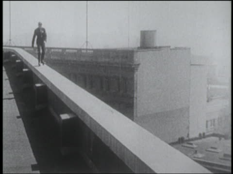 b/w 1910s man in uniform roller skating on edge of building - stunt person stock videos & royalty-free footage