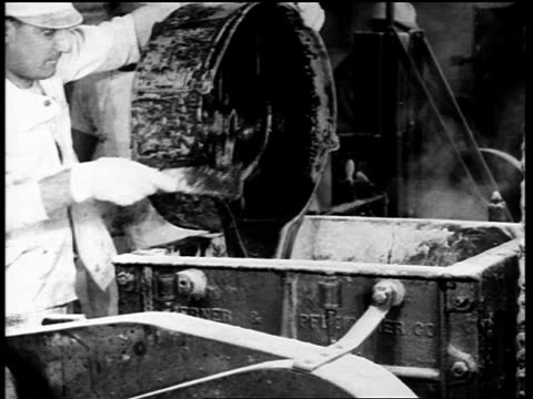 b/w 1910s men pouring + scraping dark liquid out of barrel in chewing gum factory - 1910 stock-videos und b-roll-filmmaterial
