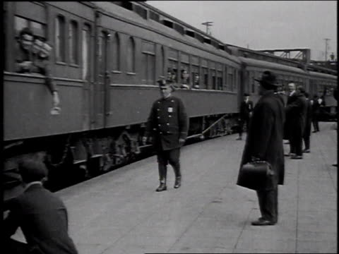 1910s WS Men waving to troops in departing train / United States