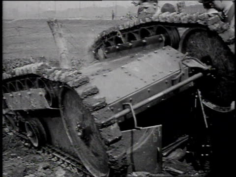 1910s montage men trying to right overturned tank / michigan, united states - wwi tank stock videos & royalty-free footage