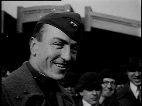 1910s montage pilot eddie rickenbacker smiling and shaking hands / united states - エディ リッケンバッカー点の映像素材/bロール