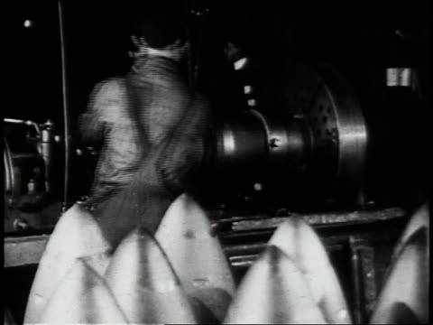 1910s montage skilled craftsmen operating machinery on the factory floor / united states - ammunition stock videos & royalty-free footage