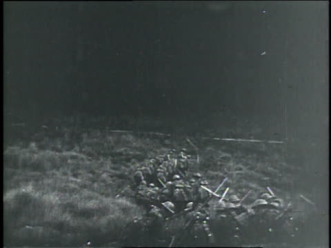 1910s montage soldiers climbing out of trench and slowly advancing across field with explosions flashing on horizon / germany - trench stock videos & royalty-free footage