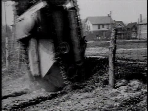 1910s montage tank running into fence and tipping over, men trying to right it / - wwi tank stock videos & royalty-free footage