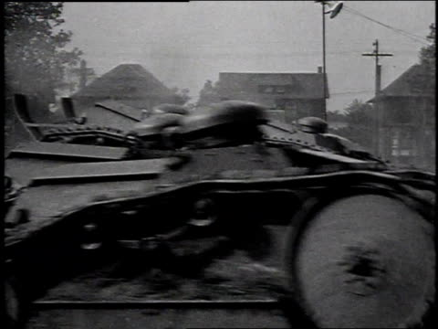 1910s montage tanks rolling across field, one fallen into ditch / michigan, united states - kampfpanzer stock-videos und b-roll-filmmaterial