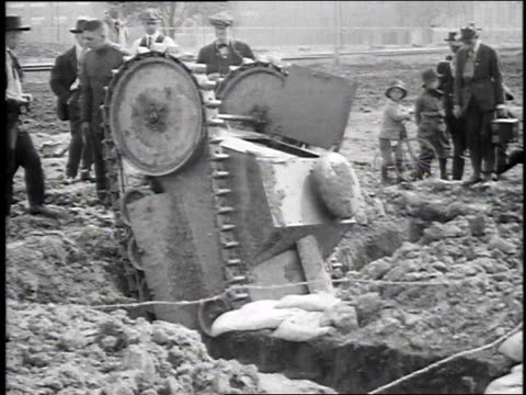 1910s montage workers trying to dig test tank out of hole / highland park, michigan, united states - wwi tank stock videos & royalty-free footage