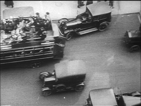 b/w 1910s overhead cars + double-decker buses driving on fifth avenue / nyc / documentary - new york city 1910s stock videos & royalty-free footage