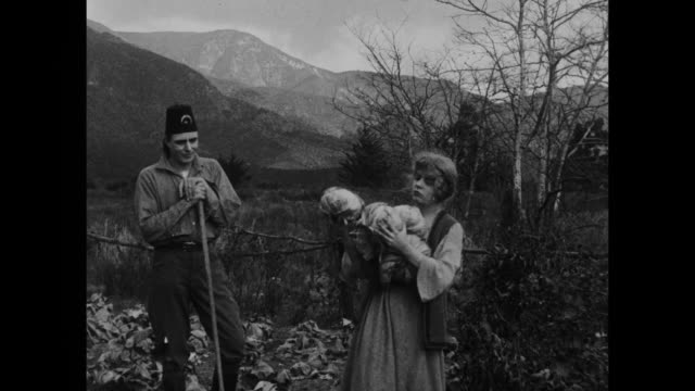 1910s peasant woman (blanche sweet) instructs turkish man (house peters) on working the cabbage crop - 1915年点の映像素材/bロール