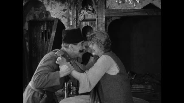 1910s Peasant woman (Blanche Sweet) staves off a Turkish invader