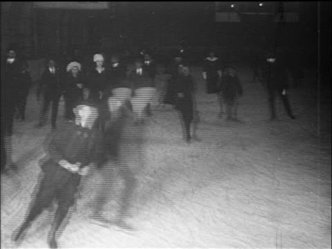 b/w 1910s people ice skating in rink / documentary - ice skating stock videos & royalty-free footage