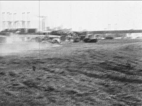 vidéos et rushes de b/w 1910s rear view wide shot car test driving on bumpy field / highland park, mi / industrial - essai de voiture