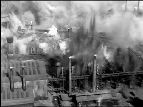 "b/w 1910s reenactment high angle wide shot large factory (model) with smokestacks exploding (world war i movie) ""the dawn patrol"" - prima guerra mondiale video stock e b–roll"