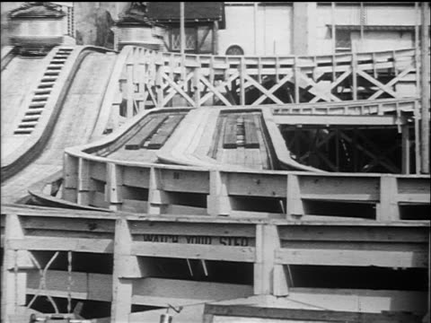 b/w 1910s roller coaster ride going past camera / coney island, nyc / documentary - 1910 stock-videos und b-roll-filmmaterial