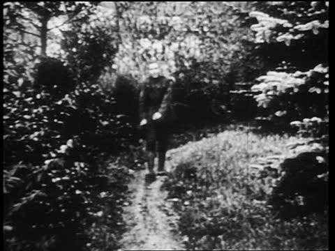 b/w 1910s shellshocked world war i veteran walking along country path while twitching / newsreel - world war one stock videos & royalty-free footage
