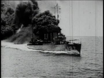 1910s ship traveling at sea leaving massive black smoke screen behind it / north atlantic - world war one stock videos & royalty-free footage