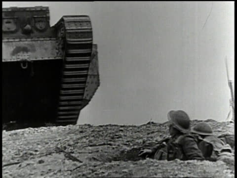 1910s ws soldier in trench gesturing as tank drives over ridge - tank stock videos and b-roll footage