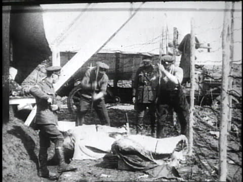 1910s soldiers chopping at sides of meat / kars, austria - turkey middle east stock videos & royalty-free footage