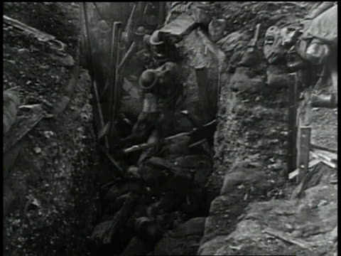 1910s ha soldiers ducking and walking in trench - trench stock videos & royalty-free footage