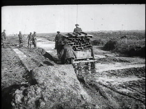 1910s soldiers in horse drawn carriage carrying wood / kars, austria - forze armate britanniche video stock e b–roll