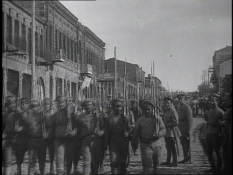 1910s soldiers marching in formation down city street/ kars, austria - turkey middle east stock videos & royalty-free footage