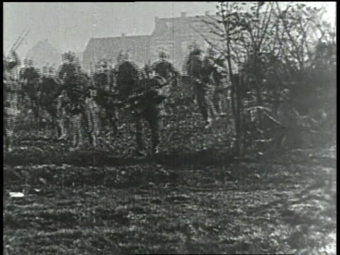 1910s ws soldiers running and jumping into trench - trench stock videos & royalty-free footage