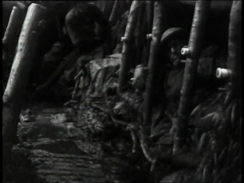 1910s ls soldiers settling into sleeping area in trench above soggy region / europe - trench stock videos & royalty-free footage